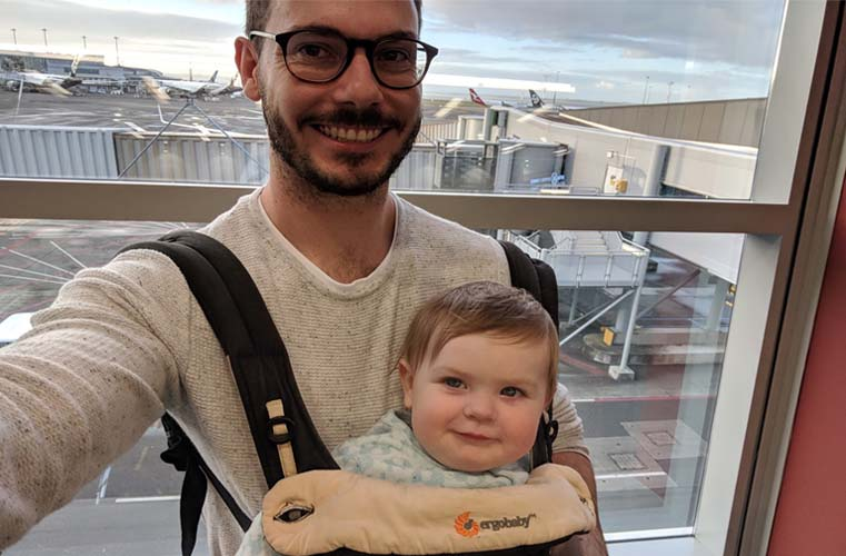 baby in baby carrier at airport